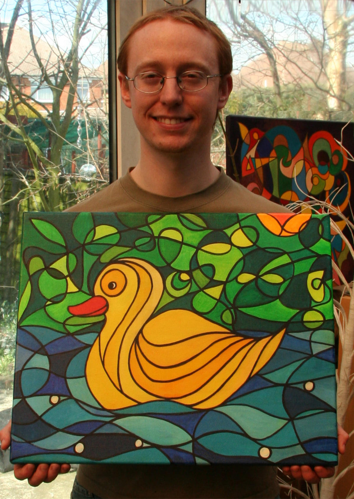 Yellow Duck Owner Alex Kent with painting