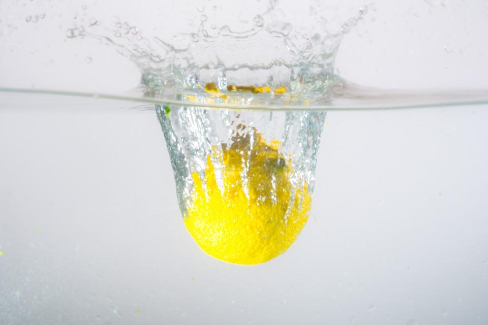 Lemon diving into water