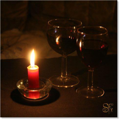 A candle and two glasses of red wine, oil painting style photograph by Silvia Hartmann
