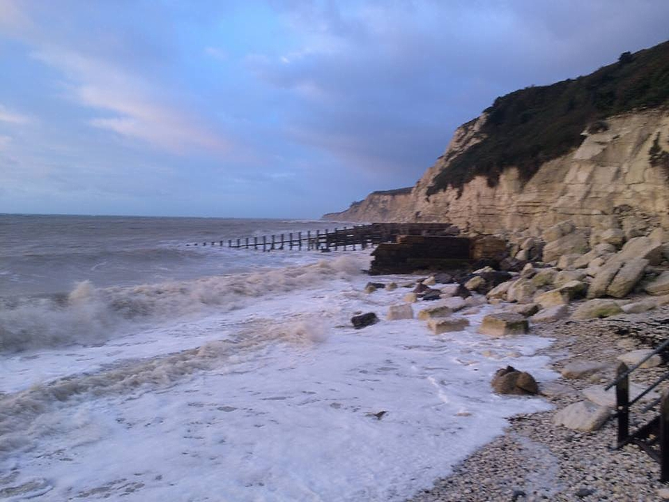 Eastbourne cliff, ocean and beachy head at sunset photo by Laura Moberg.