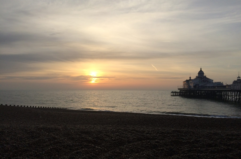 Eastbourne Pier and beach at sunset photo by Laura Moberg
